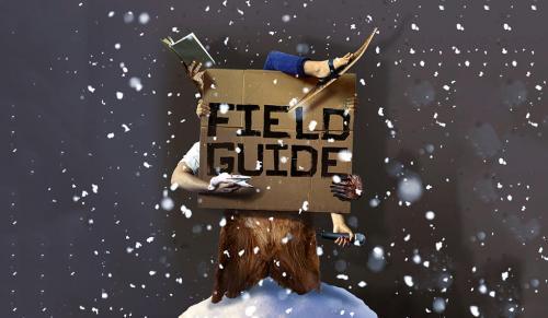 Image of man on skiis holding sign