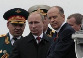 The featured photo shows  Russian President Vladimir Putin, center, flanked by Defense Minister Sergei Shoigu, left, and Federal Security Service Chief Alexander Bortnikov, right, arrives on a boat after inspecting battleships during a navy parade marking Victory Day in Sevastopol, Crimea. (AP Photo/Ivan Sekretarev, File) Friday, May 9, 2014