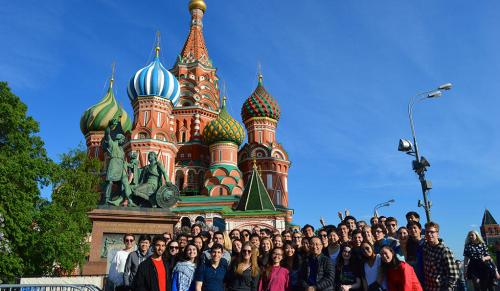 Members of the Yale Symphony Orchestra pose in front of St. Basil's Cathedral in Moscow's Red Square. (Photo by Noah Stevens-Stein)